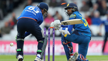Dinesh Chandimal was bowled sweeping at David Willey