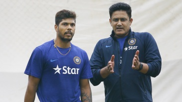 Anil Kumble has a chat with Umesh Yadav during a training camp at the National Cricket Academy