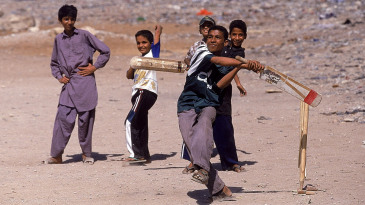 Kids play cricket in Lahore
