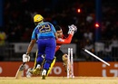 Umar Akmal takes the bails off as Nicholas Pooran is caught short of his crease, Trinbago Knight Riders v Barbados Tridents, CPL 2016, Port-of-Spain, July 1, 2016