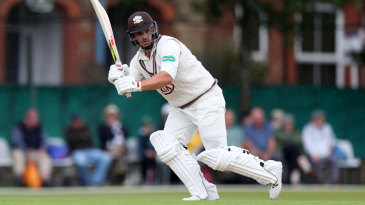 Aaron Finch anchored Surrey with a first-day hundred
