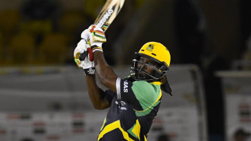 Chris Gayle bludgeons the ball down the ground