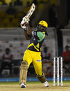 Chris Gayle bludgeons the ball down the ground, Trinbago Knight Riders v Jamaica Tallawahs, CPL 2016, Port of Spain, July 4, 2016