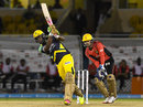 Andre Russell drives down the ground, Trinbago Knight Riders v Jamaica Tallawahs, CPL 2016, Port of Spain, July 4, 2016