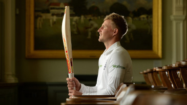 Joe Root poses with his bat in the Lord's Long Room