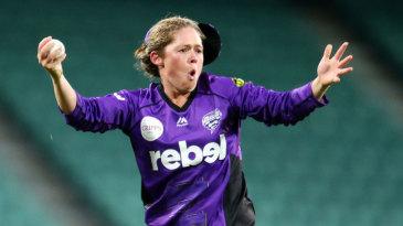 Corinne Hall celebrates taking a catch