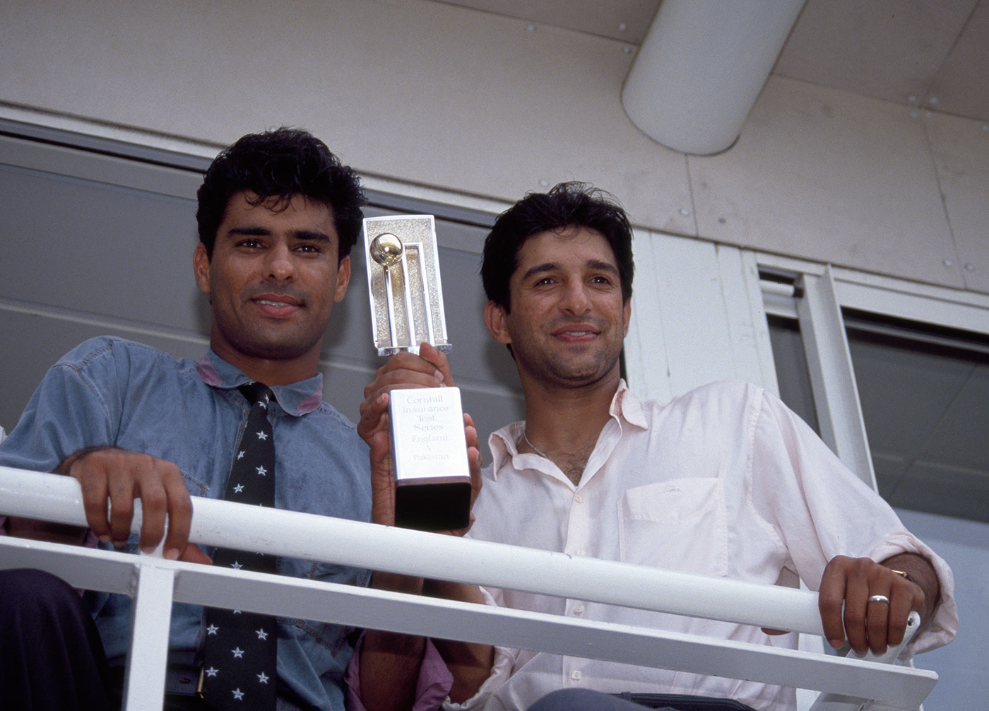 Waqar Younis (left) and Wasim Akram hold up the trophy