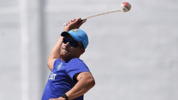 Anil Kumble sends throwdowns using the sidearm during the Indian team's practice session