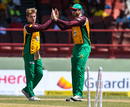 Adam Zampa and Martin Guptill celebrate the wicket of JJ Smuts, Guyana Amazon Warriors v St Kitts and Nevis Patriots, CPL 2016, Providence, July 9, 2016