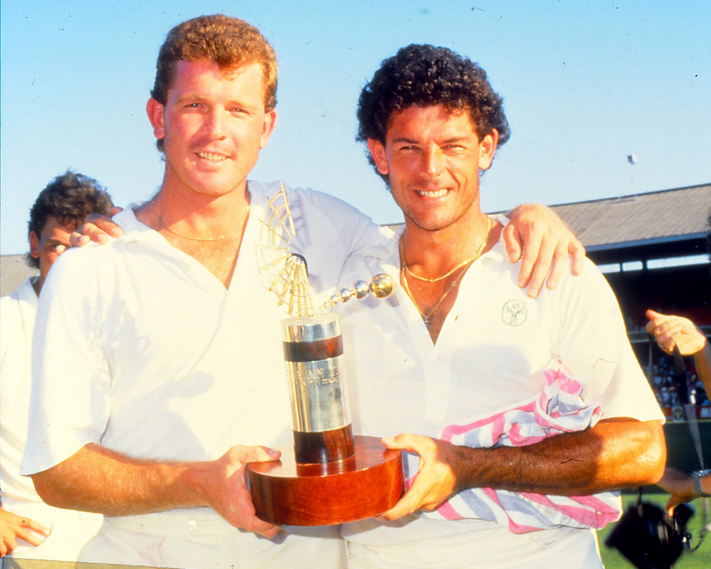 Craig McDermott and Mike Whitney hold the Trans-Tasman Trophy after the draw against New Zealand in Melbourne in 1987
