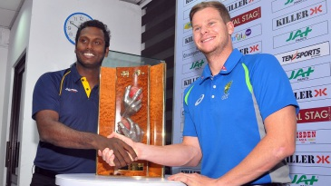 Angelo Mathews and Steven Smith pose with the Warne-Muralitharan trophy