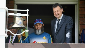 Mushtaq Ahmed rings the five-minute bell alongside MCC chief executive Derek Brewer