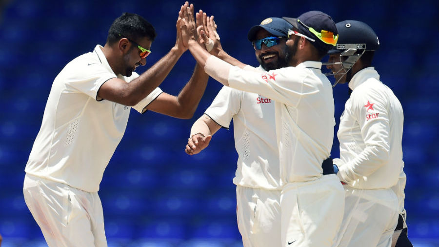 R Ashwin is congratulated by his team-mates