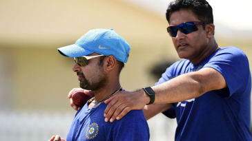 Anil Kumble and Amit Mishra at a training session