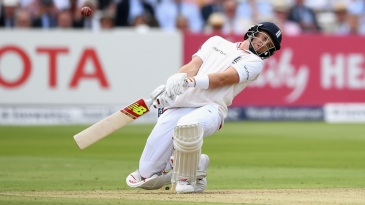 Joe Root sways away from a bouncer