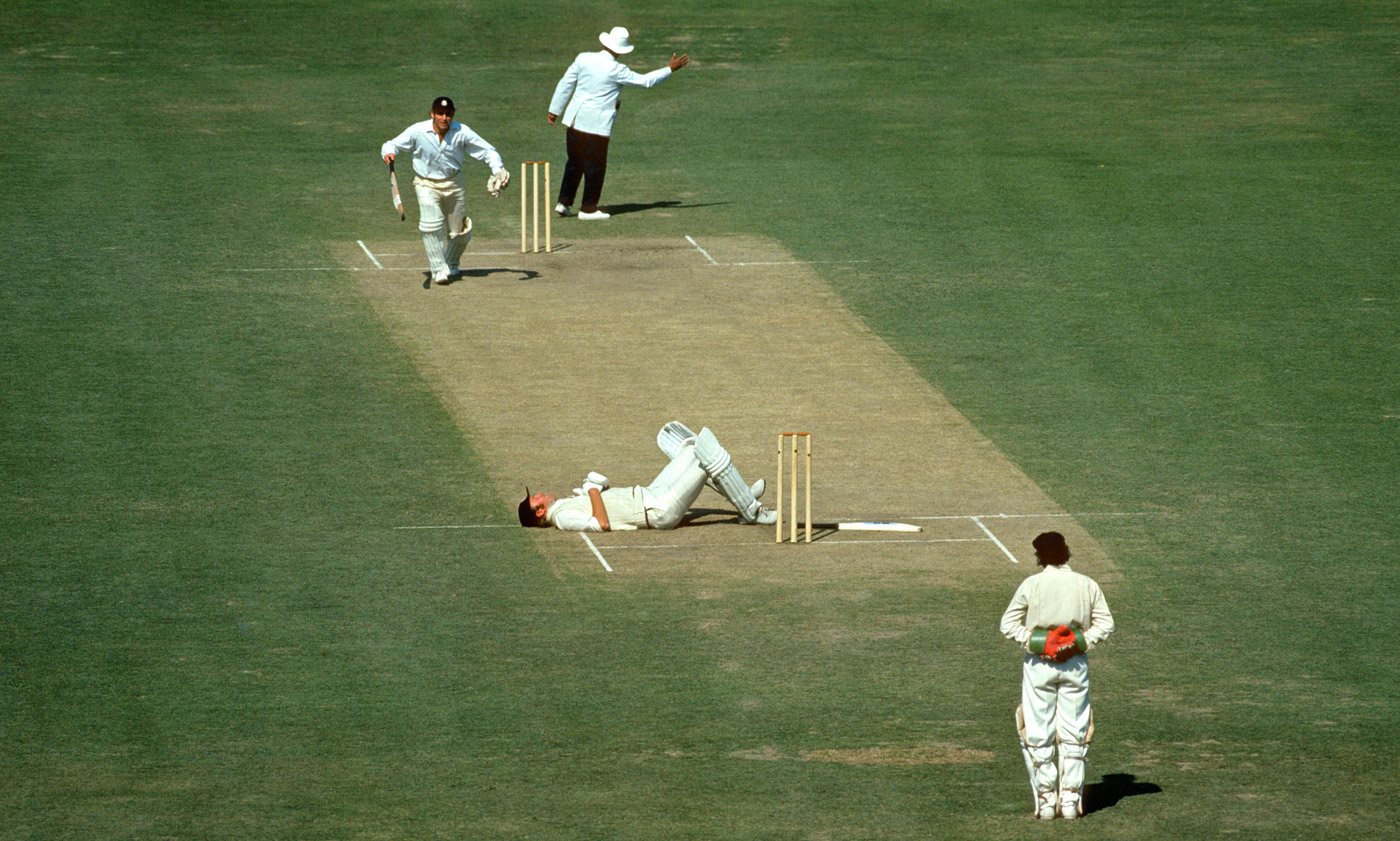 Tony the showman: Greig charms the Eden Gardens crowd in 1977 by dramatically falling to the ground after a firecracker burst
