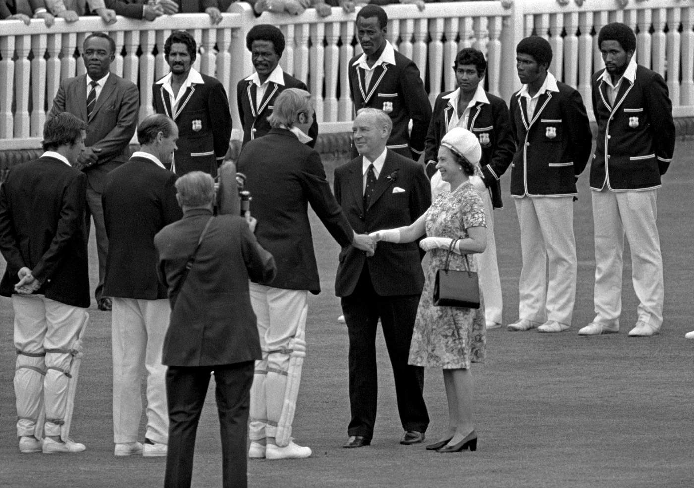 England captain Tony Greig is introduced to the Queen by Cecil Paris, the president of the MCC