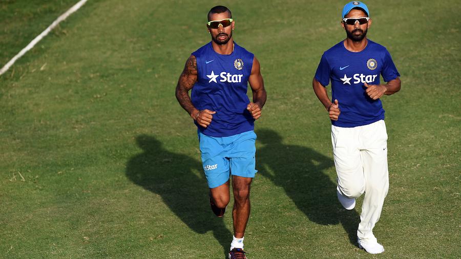 Shikhar Dhawan and Ajinkya Rahane jog around after stumps