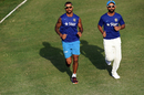 Shikhar Dhawan and Ajinkya Rahane jog around after stumps , WICB President's XI v Indians, Basseterre, 2nd day, July 15, 2016