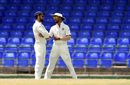Virat Kohli and Shikhar Dhawan have a chat on the field, WICB President's XI v Indians, Basseterre, 3rd day, July 16, 2016