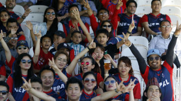 Nepal fans cheer their team on