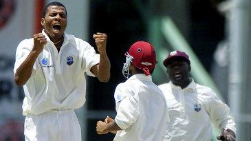 Mervyn Dillon celebrates the final wicket