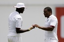 West Indies captain Jason Holder hands the ball to Shannon Gabriel, West Indies v India, 1st Test, Antigua, 1st day, July 21, 2016