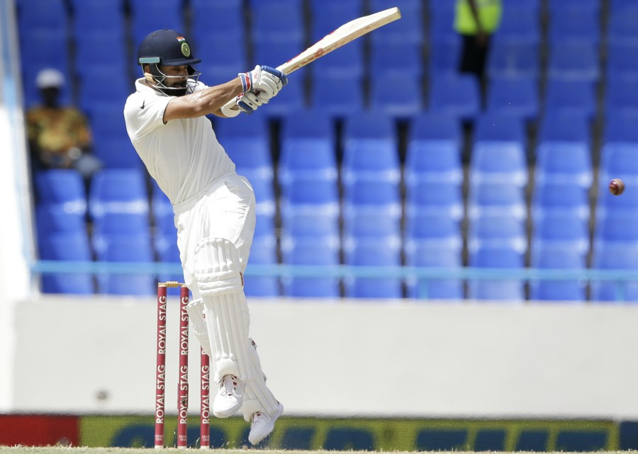 Virat Kohli resumed fluently on the second morning, quickly scoring the seven runs he needed to get to 150