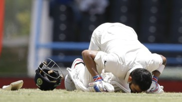 Virat Kohli kisses the pitch after reaching his double hundred