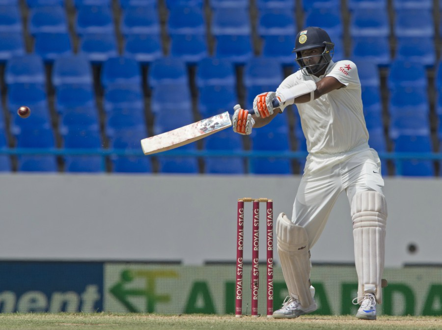 R Ashwin, reprieved on 43 by wicketkeeper Shane Dowrich, soon notched up his half-century