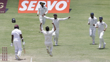 The Indian players celebrate after Mohammed Shami dismisses Darren Bravo