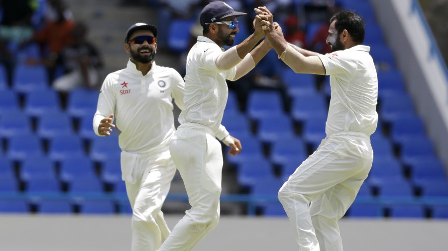 Mohammed Shami celebrates the wicket of Marlon Samuels