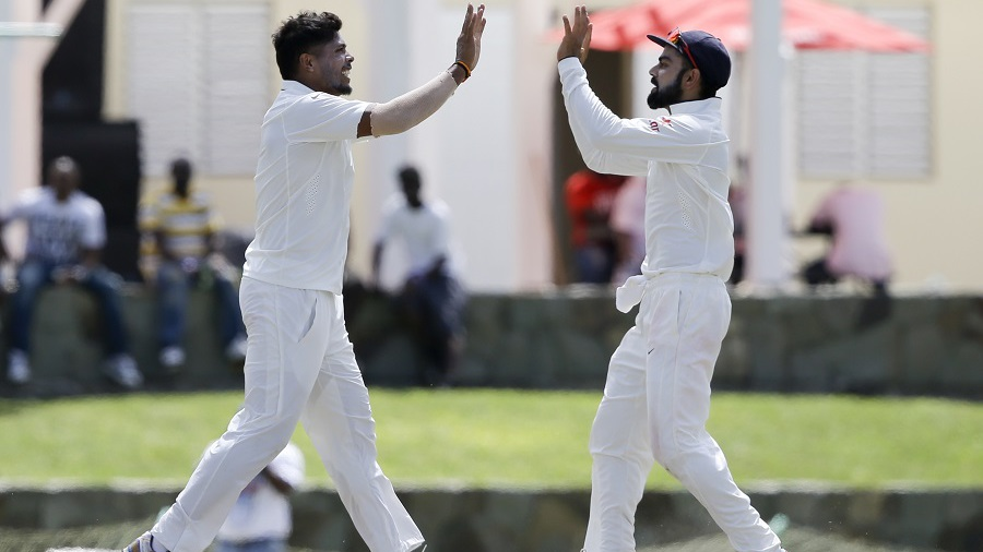 Umesh Yadav is congratulated by Virat Kohli