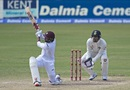 Devendra Bishoo unleashes a sweep, West Indies v India, 1st Test, Antigua, 4th day, July 24, 2016