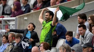 A Pakistan fan keeps his spirits up