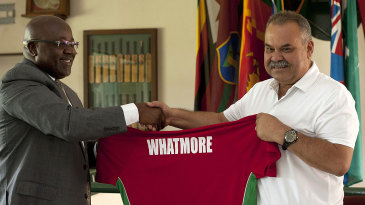 Dav Whatmore receives his personalised jersey from Zimbabwe Cricket chairman Wilson Manase