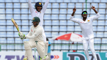 Usman Khawaja falls lbw to Dilruwan Perera after missing a sweep shot
