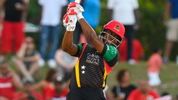 Evin Lewis launches one of his eight sixes into the Florida crowd