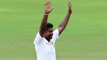 Rangana Herath celebrates after dismissing Steve O'Keefe