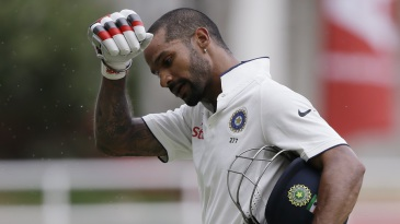 Shikhar Dhawan walks back after being dismissed