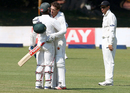 Regis Chakabva embraces Sean Williams after the latter's maiden Test century, Zimbabwe v New Zealand, 1st Test, Bulawayo, 4th day, July 31, 2016