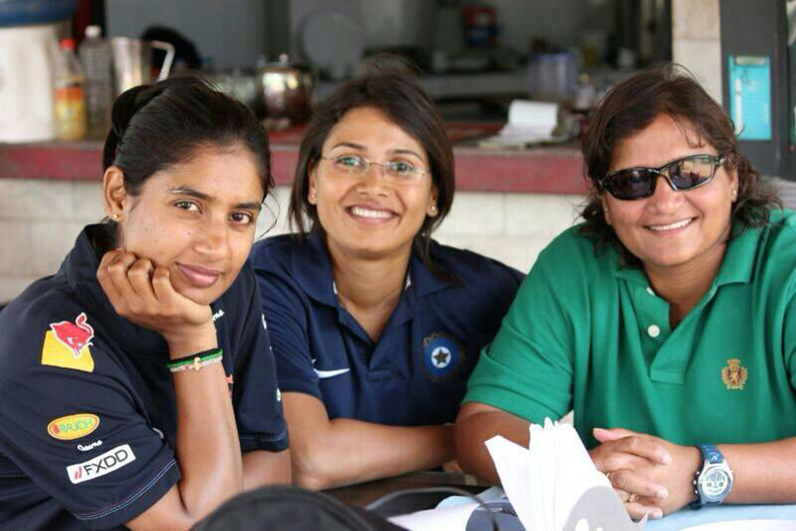 At the 2014 World T20 with assistant coach Devika Palshikar (centre) and coach Purnima Rau