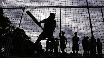 Footballer Nick Riewoldt bats in the nets