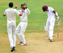 Cheteshwar Pujara and Ishant Sharma celebrate Rajendra Chandrika's dismissal, West Indies v India, 2nd Test, Kingston, 4th day, August 2, 2016