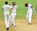 Cheteshwar Pujara and Ishant Sharma celebrate Rajendra Chandrika's dismissal, West Indies v India, 2nd Test, Kingston, 4th day, August 2, 2016