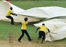 Ground staff at Sabina Park rush to cover the pitch during a spell of rain, West Indies v India, 2nd Test, Kingston, 4th day, August 2, 2016