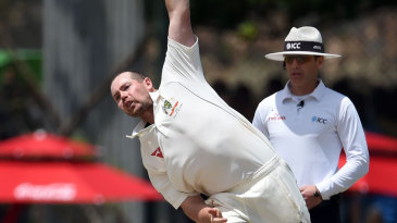 Jon Holland delivers the ball on Test debut