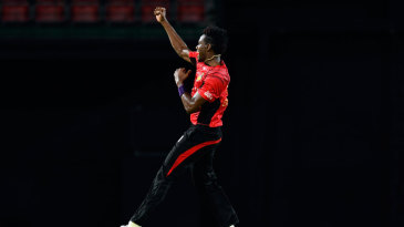 Ronsford Beaton takes flight after one of his three wickets