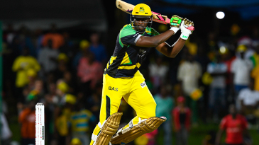Andre Russell muscles the ball through the off side