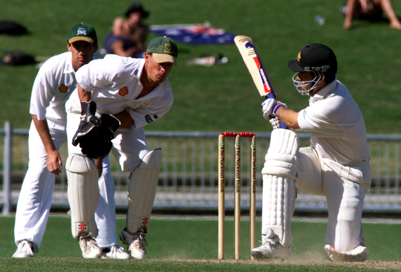 Justin Langer used his dominant top hand to caress the sweep shot towards fine leg rather than play it hard in front of square